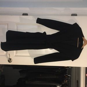 Knee length belted pea coat with hood.